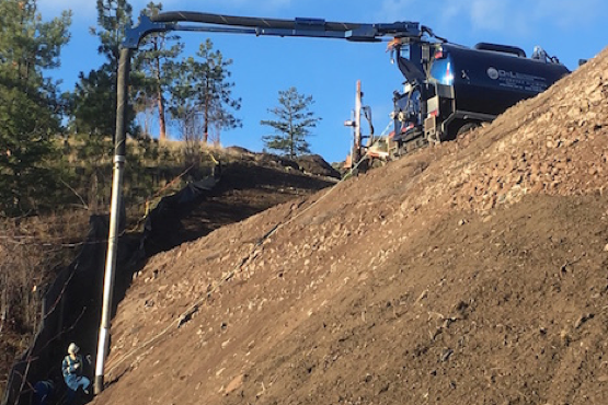 D&L Environmental Services vacuum truck with long extension hillside for hydro excavation