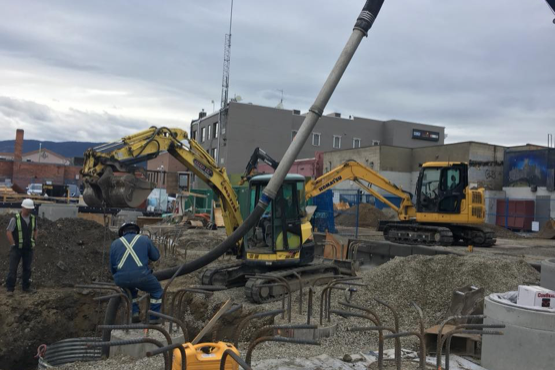 D&L Environmental Services crews at construction site with backhoes and sewer septic setup