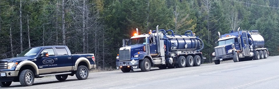 D&L Environmental Services Vacuum Trucks driving to a work site in BC.