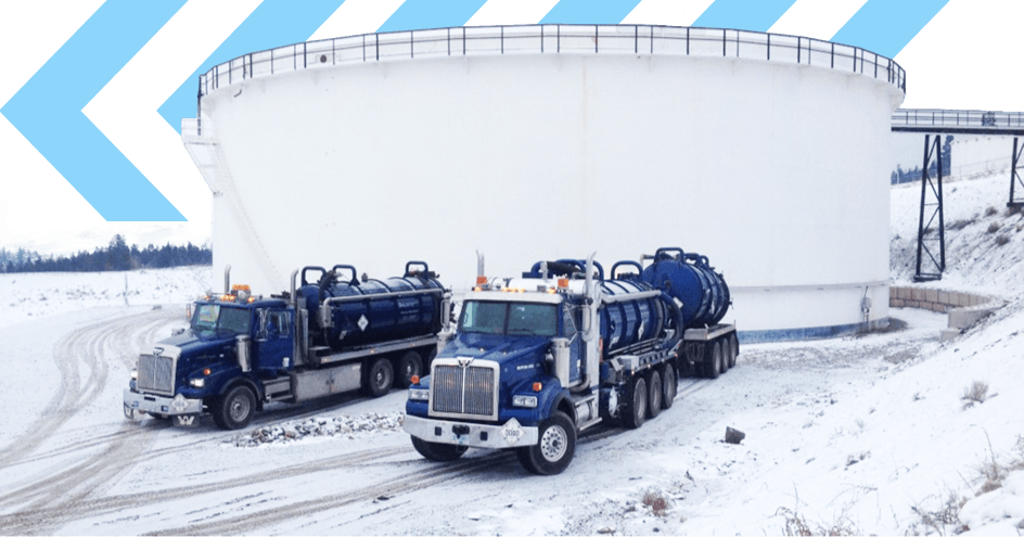 D&L Environmental Services trucks at refinery in winter snow working year-round in all conditions