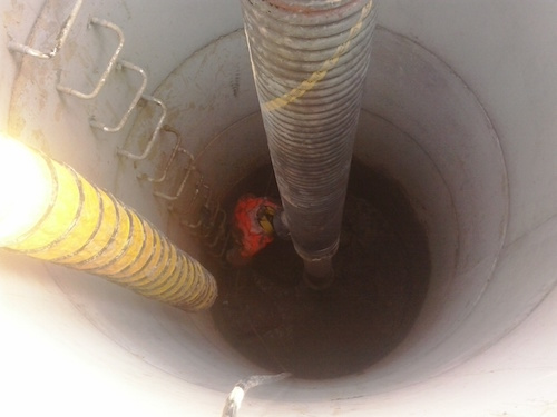 D&L Environmental worker cleaning a septic system
