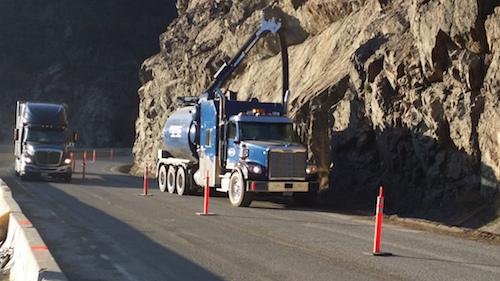 D&L Environmental Vacuum Truck driving in Kelowna BC