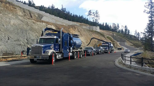 D&L Environmental Vacuum Truck driving in Kelowna BC