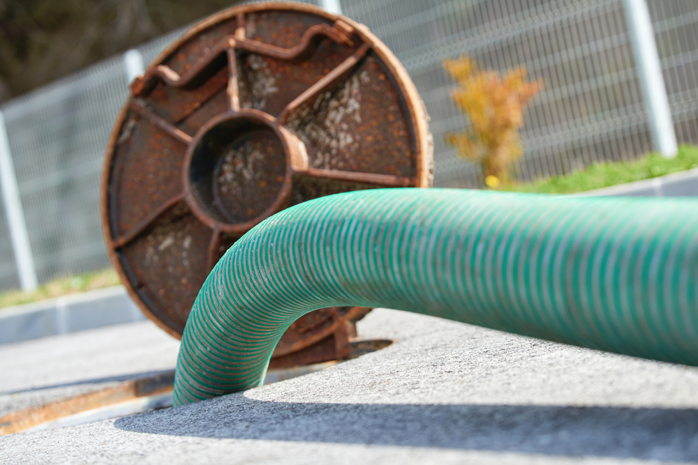 hose leading from septic tank