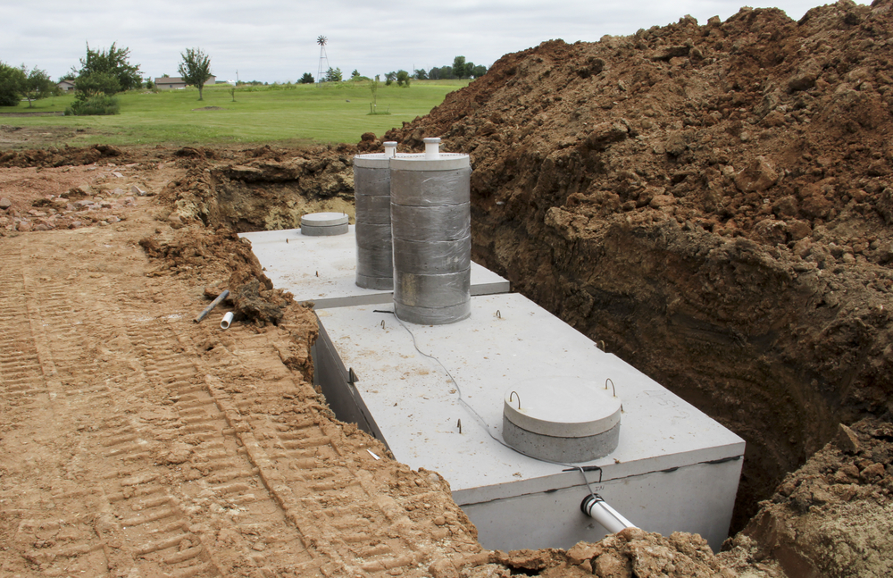 septic tank being installed in soil